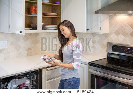 Pretty Young Brunette With Long Hair Arranging Plates