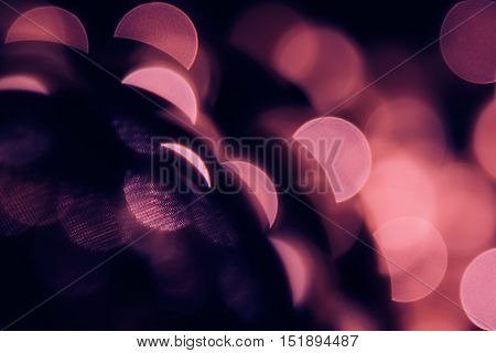 Bokeh dark pink semicircles on black background. Abstract music background.