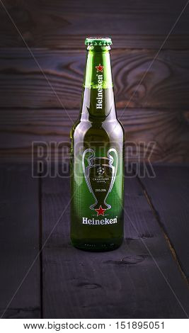 PETROPAVLOVSK-KAMCHATSKY KAMCHATKA- OCTOBER -07 2016 : Bottle of Heineken beer over wooden background. Special edition for UEFA European Championship. Heineken Lager Beer is the flagship product of Heineken International.