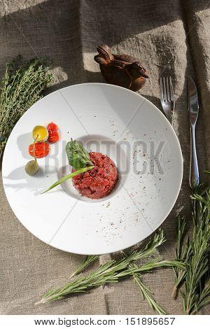 Steak tartare and raw quail egg, quail egg