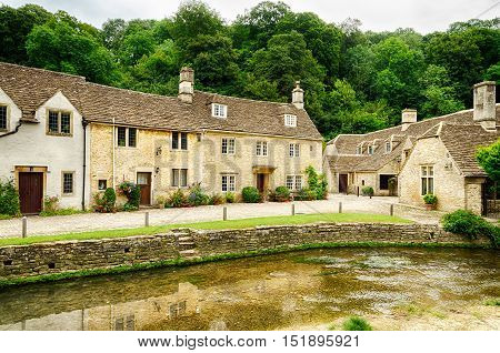 Waterway along narrow streets through Castle Combe Village in Wiltshire, England.