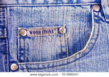 Kamchatka - October- 10 2016: Closeup of WOOD STONE's jeans texture fragment closeup background. WOOD STONE is a privately held American clothing company.
