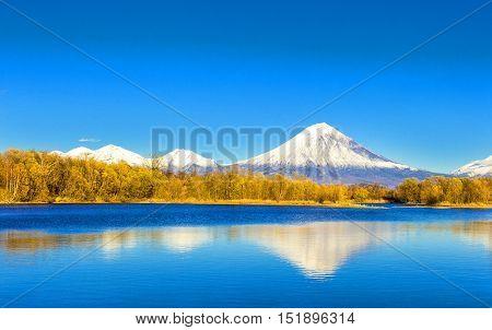 KamchatkaKoriakski volcano in autumn evening with reflection on the lake