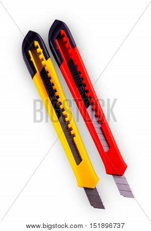 Yellow and red paper cutter with opened blade isolated on white background