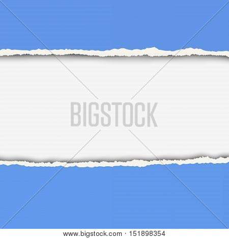 Two pieces of torn blue color paper with ripped edges and white hole between them