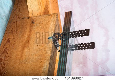 attic renovation with metal profile installation on wood