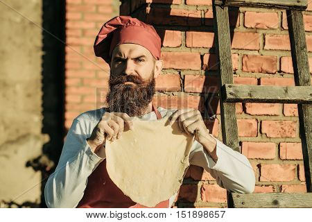 Man Cook Holding Dough