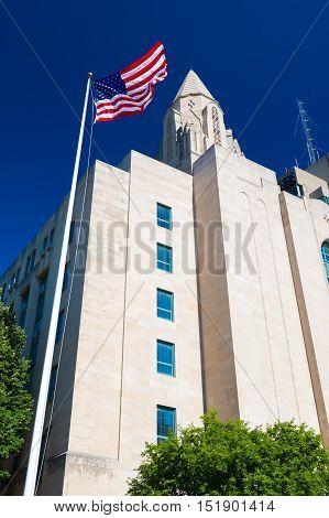 Boston, Massachusetts - June 2016, USA: Boston University building with American flag on flagpole