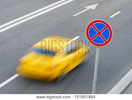 road sign stopping forbidden and a moving car