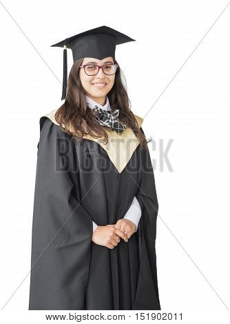 Young girl graduate of the University with eyeglasses academic cap and black gown standing isolated on white background