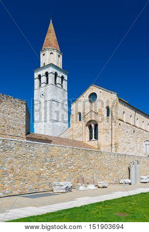 Aquileia - April 2016, Italy: Basilica di Santa Maria Assunta and Ancient Ruins in Italian city of Aquileia also known as Ancient Rome Port