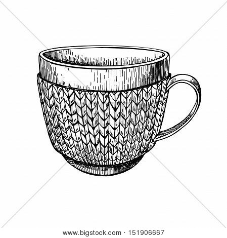 Cup in knitted cozy sweater. Hand drawn vector illustration. Warm coffee or tea drink in cold weather. Christmas sketch
