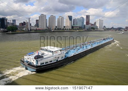 Rotterdam the Netherlands - July 13 2013: river barge moving past Rotterdam
