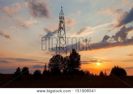 Russian geodetic point on the sunset in summer day