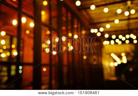 blur light in pub and bar in the dark night abstract background