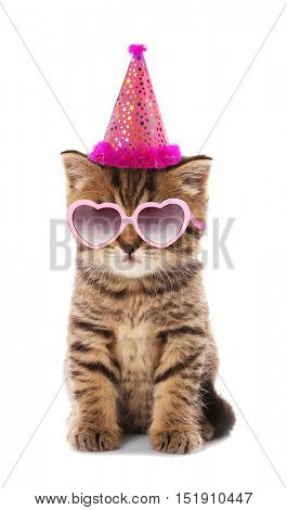 Small cute kitten in pink heart-shaped sunglasses and party hat isolated on white