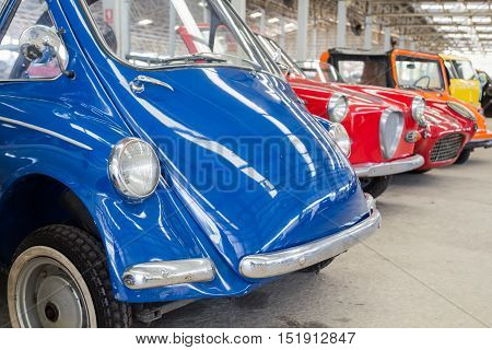 blue retro and classic car in big garage in thailand