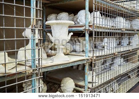 Storage shelves with gypsum models at sculpture workhouse.