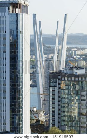 Vladivostok Primorsky kray Russia - October 12th 2016: Vladivostok a kind on the bridge through a bay the Gold Horn by new houses close up.