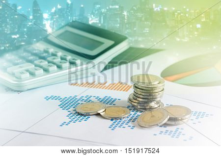 Coin Stacks And Calculator On Paper Of Financial Graph.