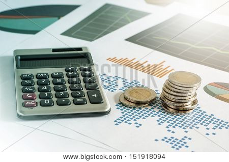 Coin Stacks And Calculator On Paper Of Financial Graph. Business Concept.