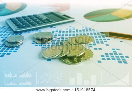 Coin Stacks, Calculator And Pencil On Paper Of Financial Graph. Business Concept.