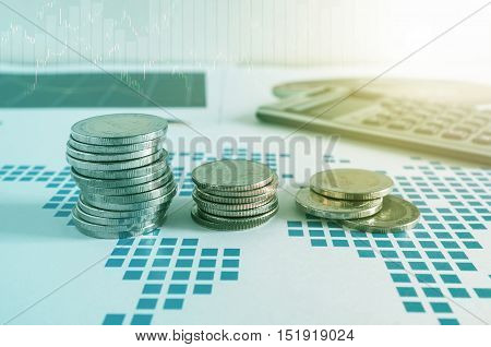 Coin Stacks And Calculator On Paper Of Financial Graph. Graphics Icons, Worldwide Stock Exchanges.