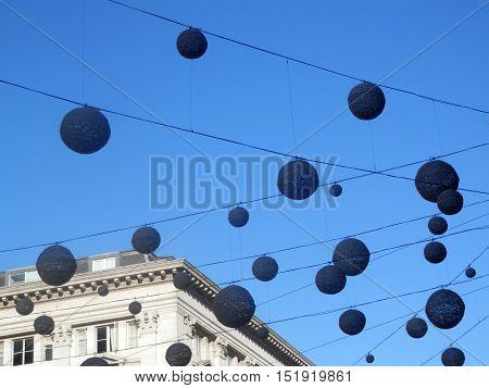 Overhead spherical globe decorations in London Street