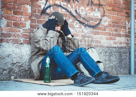 Homeless Seated In The Street And Feeling Desperate