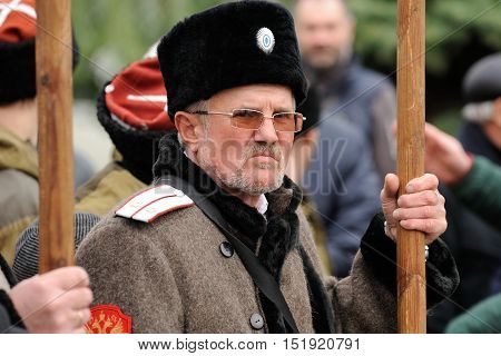 Orel Russia - October 14 2016: Ivan the Terrible monument opening ceremony. Grumpy man in cossack uniform holding banner and loking at camera