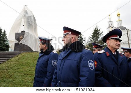 Orel Russia - October 14 2016: Ivan the Terrible monument opening ceremony. People in cossack uniform and Ivan the Terrible monument covered white cloth