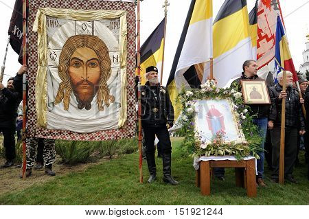 Orel Russia - October 14 2016: Ivan the Terrible monument opening ceremony. Russian ultra-orthodox clerical group with Russian Empire Christ banners and orthodox icons with Jesus Christ