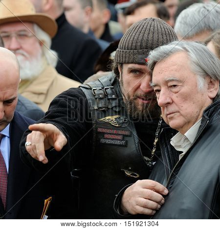 Orel Russia - October 14 2016: Ivan the Terrible monument opening ceremony. Alexander Surgeon (Hirurg) Zaldostanov talking to Alexander Prohanov closeup