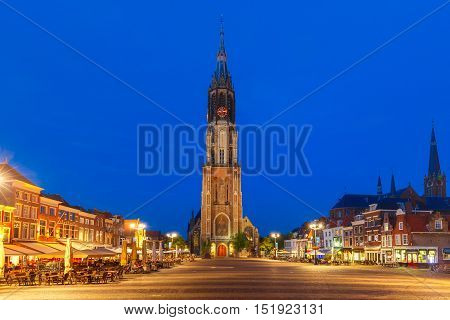 Gothic Protestant Nieuwe Kerk, New church on Markt square in the center of the old city at night, Delft, Holland, Netherlands