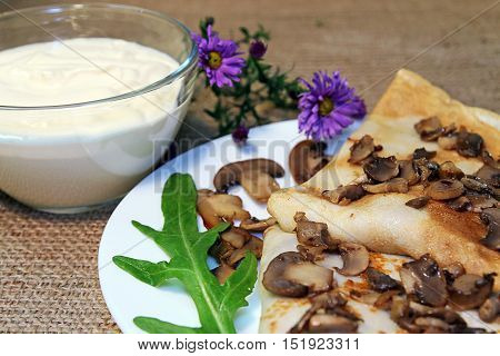 Fritters with fried mushrooms and sour cream