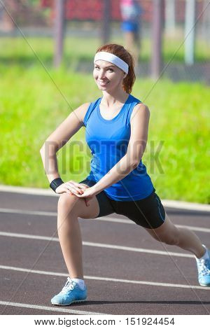 Happy Smiling Female Caucasian Athlete During Her Warming-up Training Outdoors.Vertical Shot
