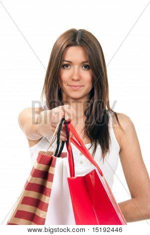 Woman Giving Shopping Bags