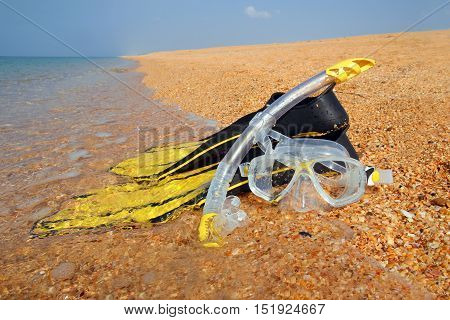 The Mask And The Fins On The Beach