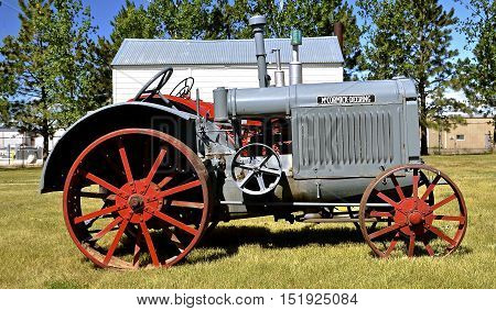 WATFORD CITY, NORTH DAKOTA, June 23, 2016: A vintage McCormick Deering is displayed at the Watford City Pioneer Museum which is open and free to the public.