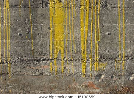 Dirty gray Industrial Concrete Wall With Fat Yellow Paint Drips