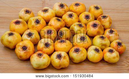Hawthorn Fruit On A Wooden Board