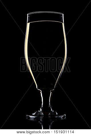 Glass of beer cider with yellow lines on black background