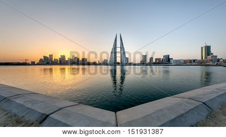 MANAMA, BAHRAIN - OCTOBER 14, 2016: Beautiful view of the World Trade Center and other high rise buildings in the city in the morning- panoramic view