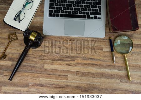 Workspace hero header with law gawel, legal book and laptop keyboard, top view, copy space on wooden table background