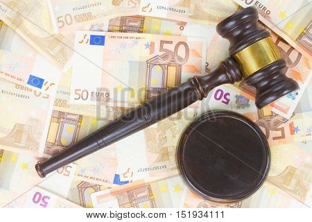 Wooden Law Gavel and Euro Money Banknotes