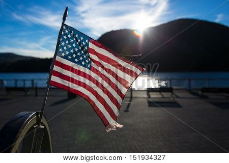 American flag is waving in lake background