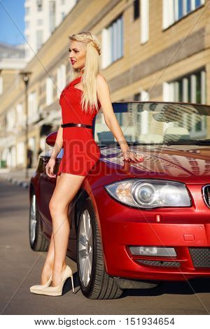 MOSCOW - SEP 13, 2015: Pretty woman (with model release) goes near BMW cabriolet car, Company was founded by Karl Friedrich Rapp in October 1916