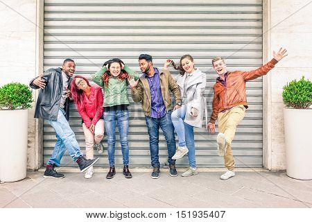 Multiracial people with many facial expressions lined up on the street - Multiethnic friends acting funny moods in a row outdoors - Concept of different characters and uniqueness of human society