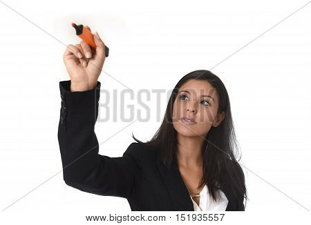 young attractive latin businesswoman in office suit writing with marker on invisible virtual screen or board isolated on white background in business concept