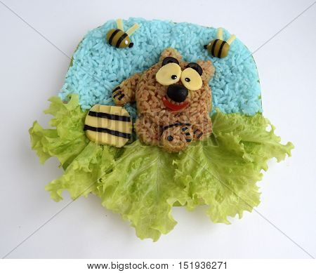 The cheerful bear is made of rice. Ridiculous food for good mood and appetite